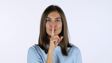 Finger on Lips, Silence Gesture by Beautiful Girl, White Background in Studio