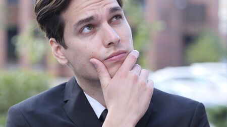 fantasize: Thinking Pensive Businessman in Suit, Outdoor
