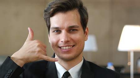 Stay Connected, Phone Call Gesture by Businessman