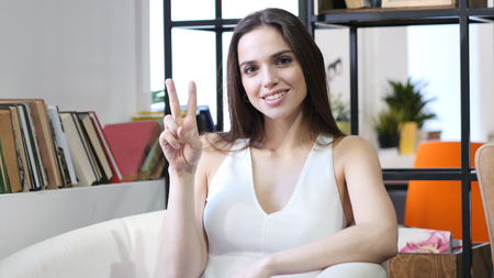Woman Showing Victory Sign, Indoor
