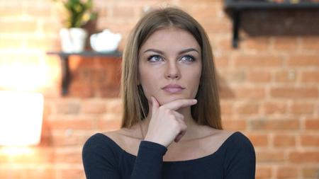fantasize: Thinking, Portrait of Beautiful Young Girl Stock Photo