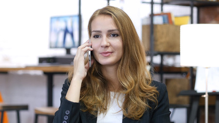 Portrait of Working Girl, Talking on Phone at Work