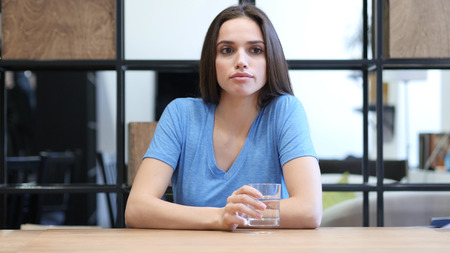 Brainstorming Serious Female Brunette Woman Sitting in Office