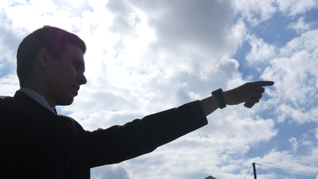 Silhouette of Businessman Showing Direction, Leader Pointing with Finger,