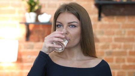Girl Drinking Water, Indoor Office