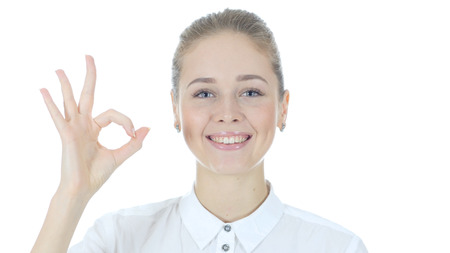 Young Woman Showing Ok Sign, White Background