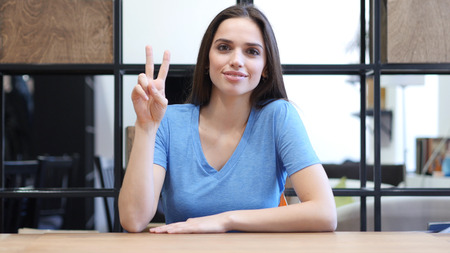Beautiful Brunette Woman Showing Victory Sign, Indoor