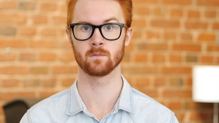 Red Hair Beard Young Man in Glasses