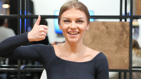 Thumbs Up By Young Girl, Portrait Stock Photo
