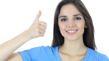 Thumbs Up By Young Woman, White Background Stock Photo
