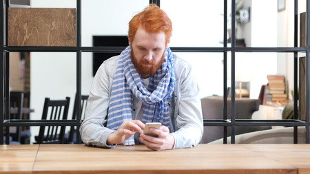 web browser: Man Browsing on Smartphone, Sitting in Office