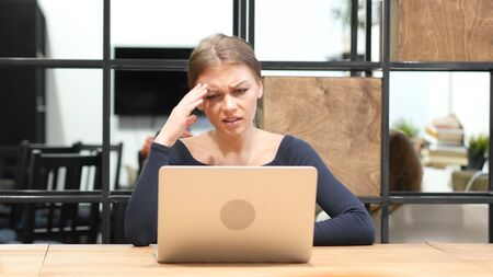 Business Loss for Girl Working on Laptop, Front View