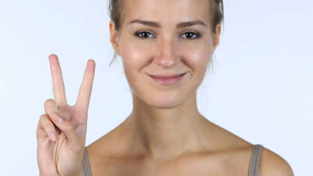 fantasize: Victory Sign, Close up of Successful Beautiful Girl, White Background Stock Photo