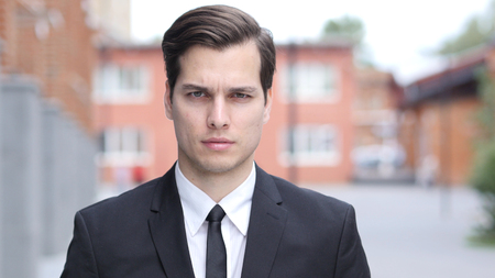 Portrait of Young Businessman in Suit, Outside Office