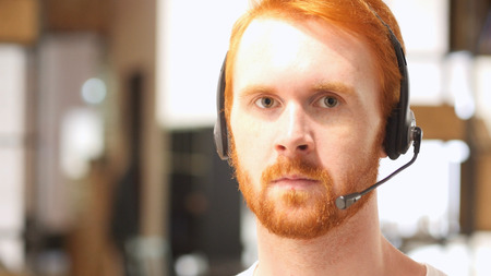 caller: Portrait man with headset , call center
