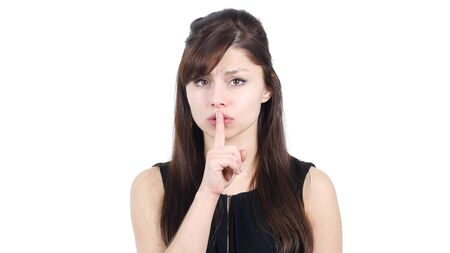 Gesture of Silence by Young Girl, Finger on Lips