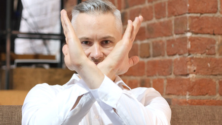 No, Rejecting Gesture by Middle Age Man