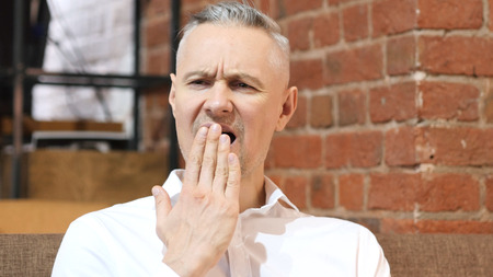 Yawning Tired Middle Age Man, Portrait Stock Photo