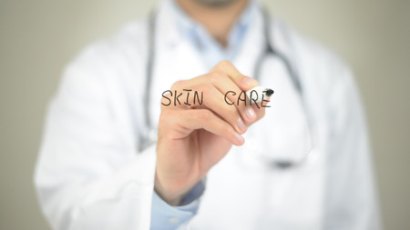 Skin Care, Doctor writing on transparent screen Stock Photo
