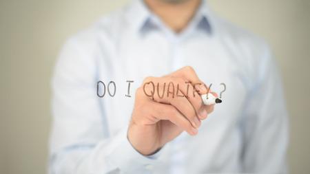 Do I Qualify , man writing on transparent screen Stock fotó