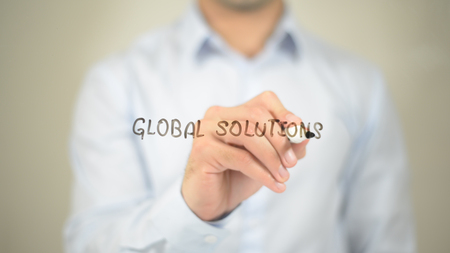 Global Solutions,  Man writing on transparent screen Stock Photo