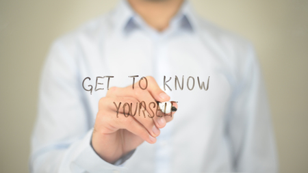 Get to Know Yourself , Man writing on transparent screen Standard-Bild