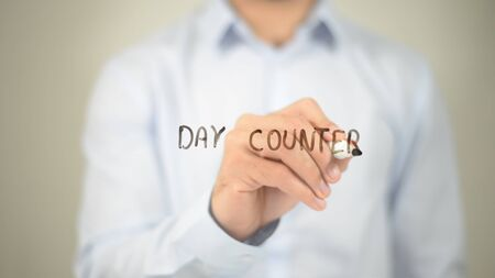 Day Counter, man writing on transparent screen