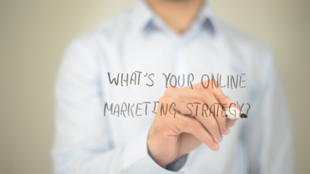 Whats Your Online Marketing Strategy, man writing on transparent screen