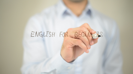 English For Beginners , man writing on transparent screen