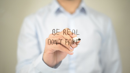 Be Real Dont Fake, Man writing on transparent screen Stock Photo