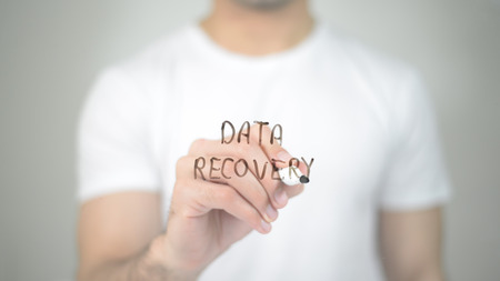 Data Recovery, man writing on transparent screen Stock Photo