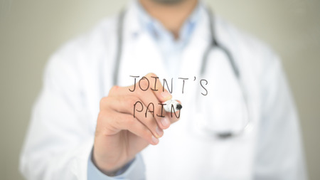 pain: Joints Pain, Doctor writing on transparent screen Stock Photo