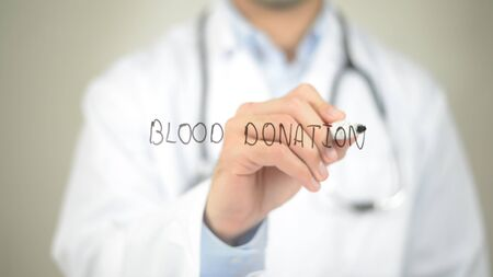 rh: Blood Donation, Doctor writing on transparent screen
