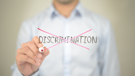 No Discrimination,,  Man writing on transparent screen Stock Photo