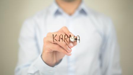 Karma   ,  man writing on transparent wall