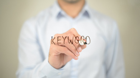 keyword: Keyword,  Man writing on transparent screen Stock Photo