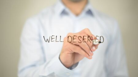 great: Well Deserve   ,  man writing on transparent wall