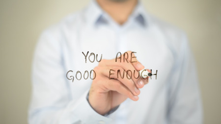 You Are Good Enough   ,  man writing on transparent wall