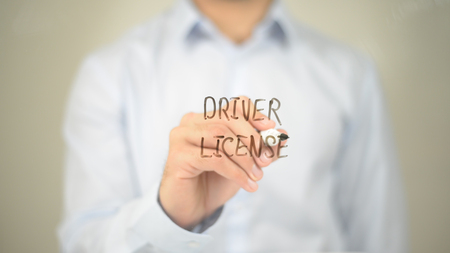 Driver License, Man writing on transparent screen Stock Photo
