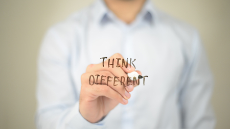 Think Different,  Man writing on transparent screen Stock Photo