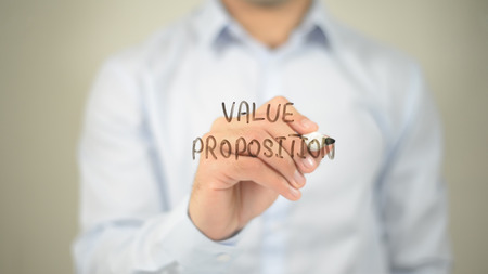 Value Proposition , man writing on transparent screen