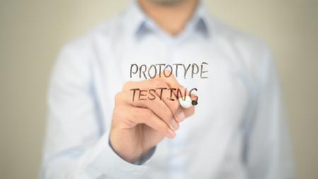 Protype Testing , Man writing on transparent screen Stock Photo