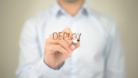 Deploy, Man writing on transparent screen 스톡 콘텐츠