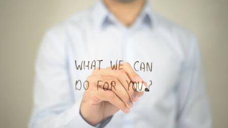 私たちはあなたのため行うことができますか。、男は透明なスクリーンに書く 写真素材
