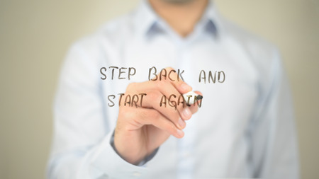 Step Back and Start Again, Man Writing on Transparent Screen Фото со стока