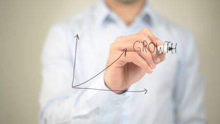 Growth,  Man writing on transparent screen