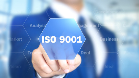 ISO 27001, Businessman working on holographic interface, Motion Graphics Stock Photo
