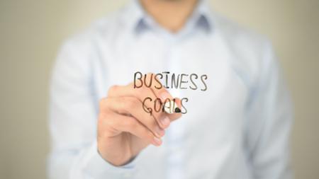 Business Goals,  Man writing on transparent screen