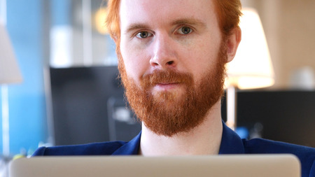 Man Looking toward Camera, Working in Office