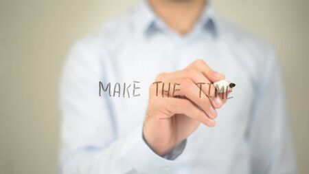 Make the Time , Man writing on transparent screen